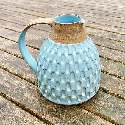 Stoneware jug with carving in a Robin's egg glaze