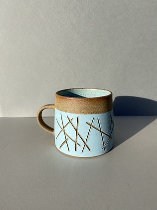 Stoneware mugs with random pattern