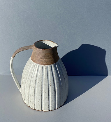 Stoneware jug with White glaze and incised grooves