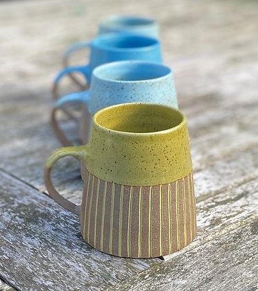Stoneware mugs with inlaid slip
