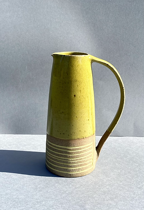Stoneware jug with inlaid slip and a yellow glaze