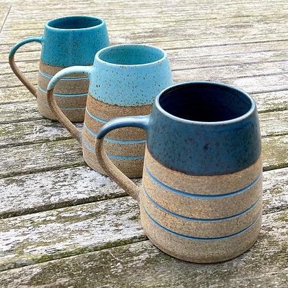 Stoneware mugs with inlaid slip glaze.