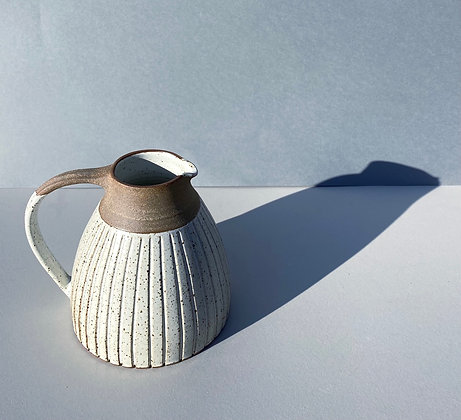 Stoneware jug with White glaze and incised lines