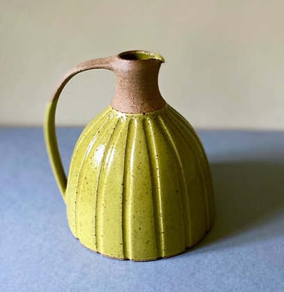 Stoneware jug in yellow glaze