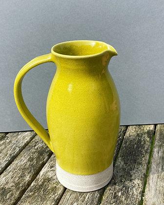 White stoneware jug in bright yellow glaze
