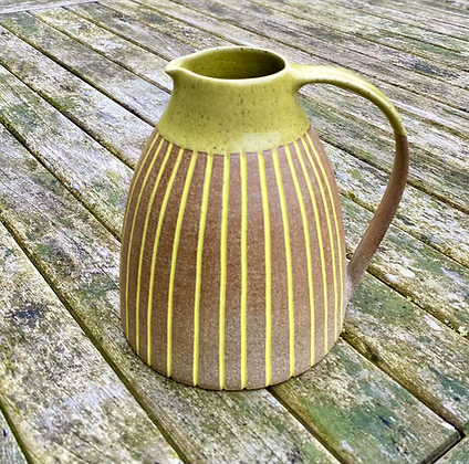 Stoneware Jug with yellow glaze and inlaid slip lines