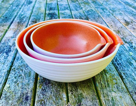 Porcelain pouring bowls in an orange glaze