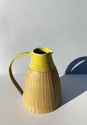 Stoneware Jug with yellow glaze and inlaid slip lines