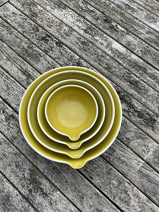 Porcelain pouring bowls with a satin yellow glaze