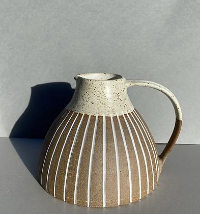 Stoneware jug with speckled white glaze
