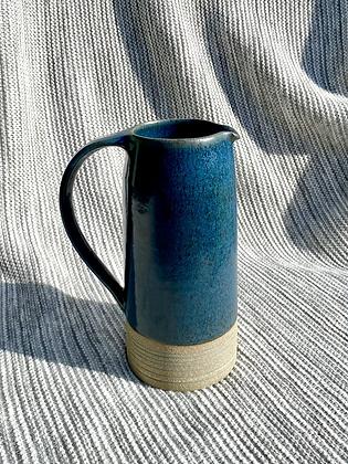 Stoneware jug in Deep sea blue glaze  with inlaid slipped horizontal lines