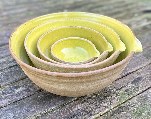 Large set of Stoneware pouring bowls with a yellow glaze
