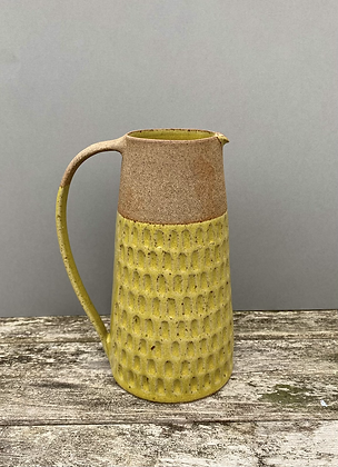 Stoneware jug with yellow glaze