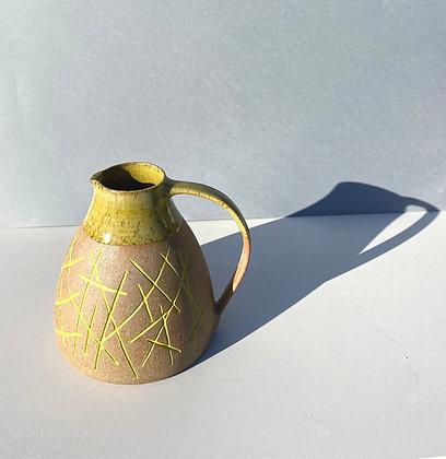 Stoneware Jug with inlaid slipped pattern and yellow glaze