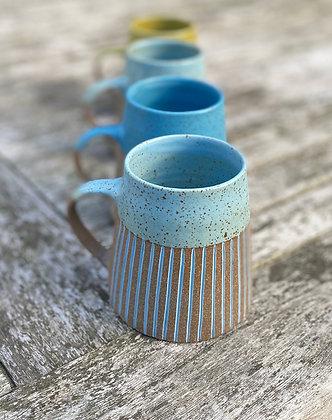 Stoneware mug with inlaid slip