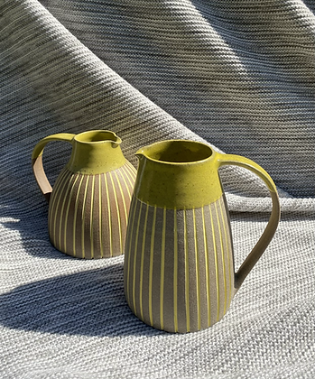 Stoneware Jug with inlaid slipped lines and a satin yellow glaze