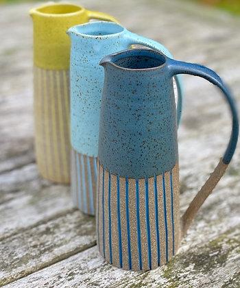Stoneware jug with deep sea blue glaze and inlaid slip lines