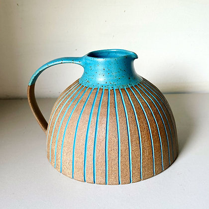 Wide stoneware jug with peacock blue glaze