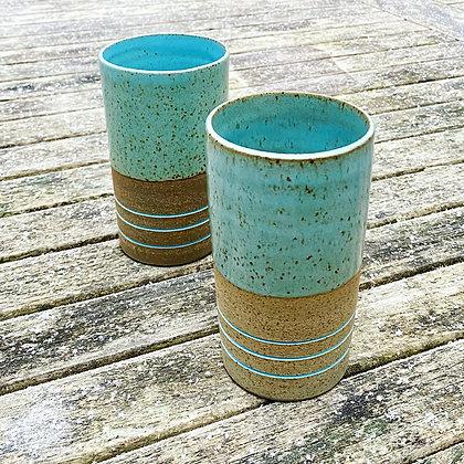 Stoneware beakers with inlaid slip and duck egg glaze