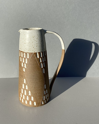 Stoneware jug with speckled white glaze and diamond pattern