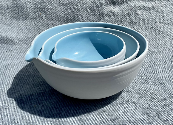 Porcelain pouring bowls with a satin sky blue glaze