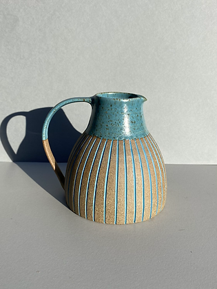 Stoneware jug with peacock blue glaze
