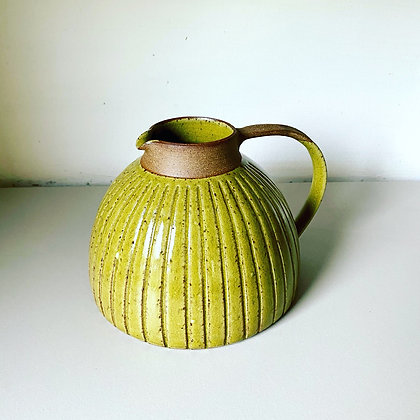 Stoneware jug with incised lines and satin yellow glaze