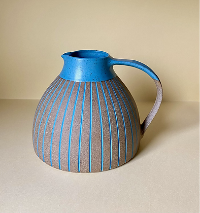 Stoneware jug with peacock blue glaze and inlaid slip lines