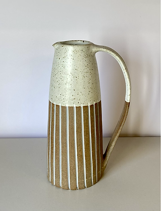 Stoneware Jug with inlaid slipped lines and a white glaze