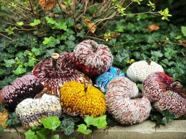 Celebrate fall... Hand-knit scrap-yarn pumpkins!