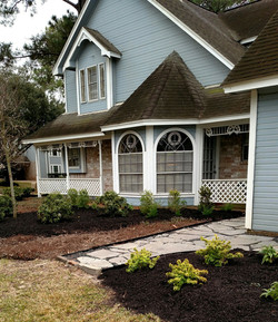 New gray slate walkway leads to driveway.