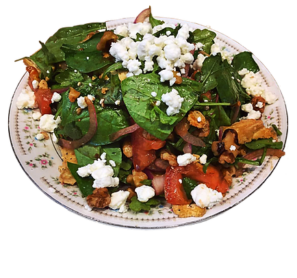 Lunch salad containing feta cheese, tomato slices, spinach, and cooked chicken slices  on a porcelain plate.