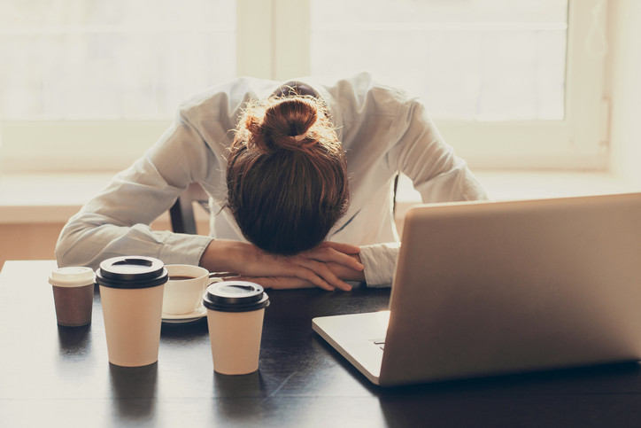 Catherine and Co. tired woman in office stressed