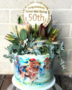 A watercolour horse racing cake for horse trainer Darren Weir to celebrate his 50th May race win