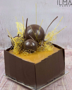 A gluten free mud cake filled with salted caramel covered in a caramel glaze, topped with toffee and