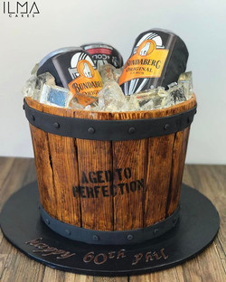 Aged to perfection! Bundy ice bucket cake complete with hand painted wooden bucket and fully edible!