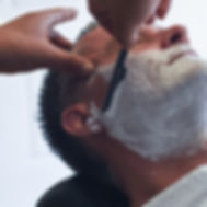 Sam the Boonton barber shaving a customer