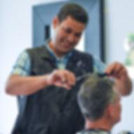 Sam the barber cutting hair
