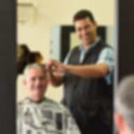 Sam the Boonton Barber giving a haircut