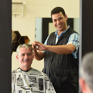 Sam the Boonton Barber giving a haircut
