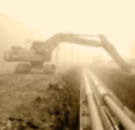 excavator%2520beside%2520large%2520pipes_edited_edited.jpg