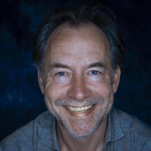 Dominic Mafham smiling headshot