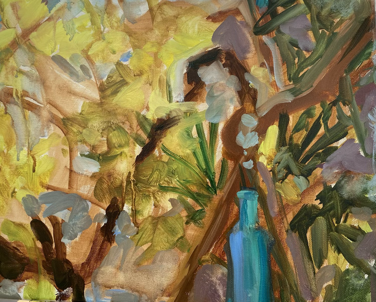 Turquoise bottle hanging from vine