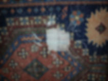 repairing a hole in an oriental rug in London