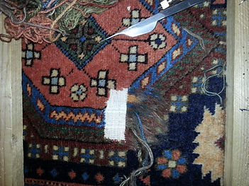 repairing a hole in a rug. London, Welwyn , Hatield, Harpenden, St Albans