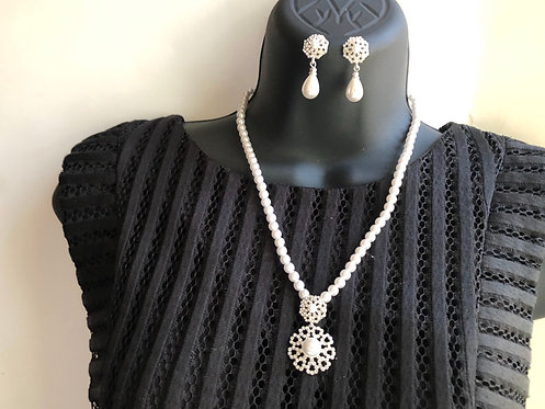 Pearl and rhinestone necklace and earrings