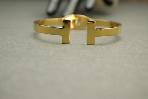 gold T bracelet