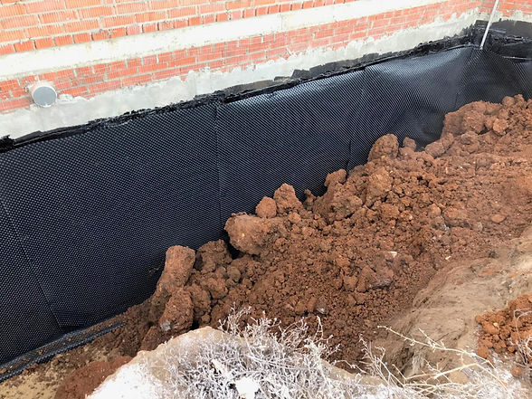 homeguide-contractors-waterproofing-the-foundation-with-protective-membrane.jpg