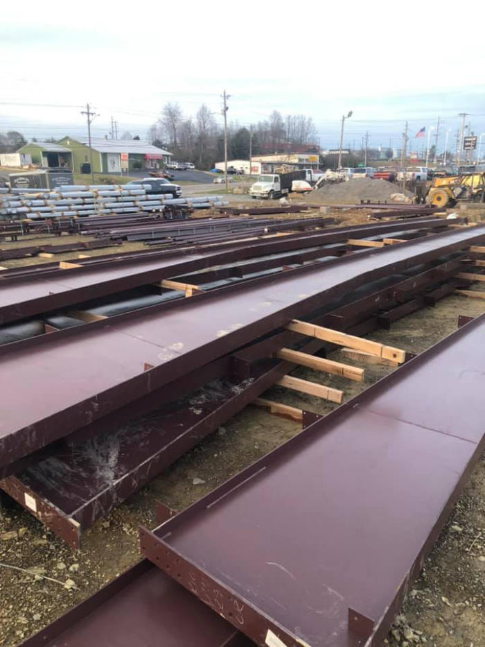 Joe Hudson's Collision Center steel beams staged on construction site
