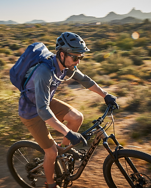 mountain biker with a hydration pack on.